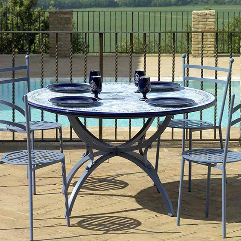 Table top in design Delfino together with four chairs